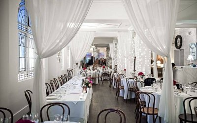Hotel Richmond wedding venue Adelaide; wedding reception venue set-up with round tables and pin flowers