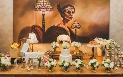 Wedding cake and gift table setup at Hotel Richmond with 1920's painting as backdrop
