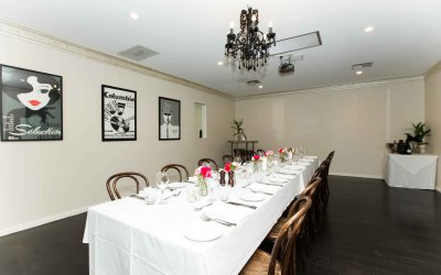 Long table set for private dining in the Green Room at Hotel Richmond